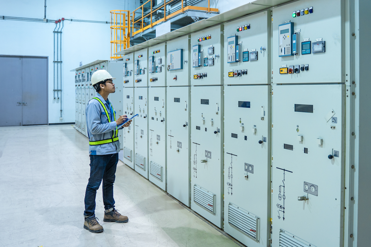 Engineer working and check status switchgear electrical energy distribution at substation room, maintenance engineers inspect relay protection system electric concept, Medium voltage switchgear
