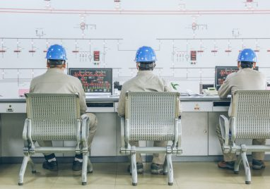 workers in control room - Energy